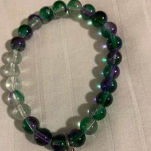 Green and clear beaded bracelet with an angel wing